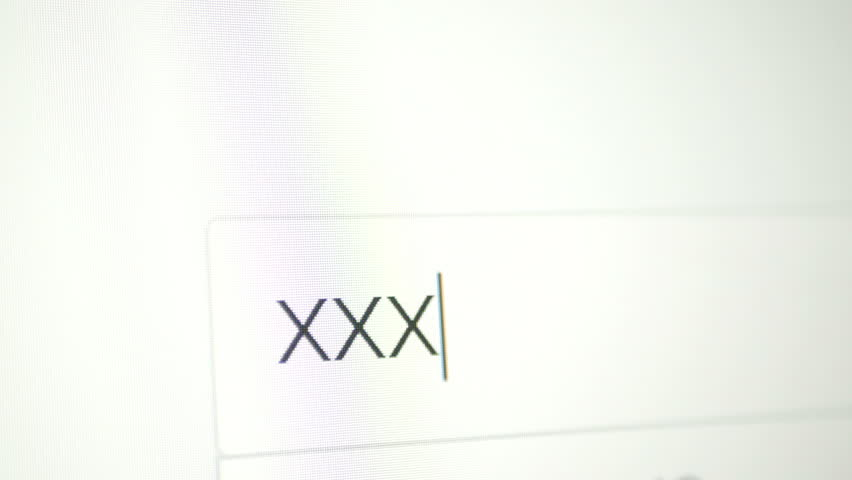 Internet Search Engine - typing XXX. Monitor, computer screen with reflection hands typing. text and cursor.