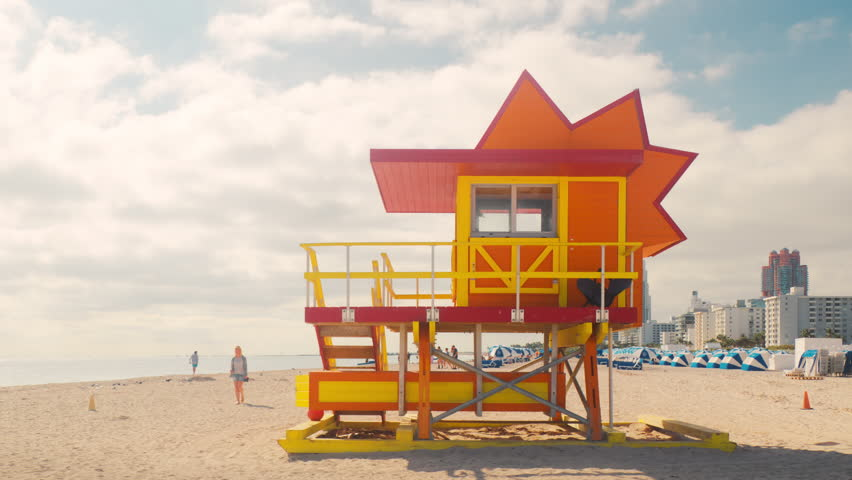 South Beach Miami Art Deco lifeguard hut timelapse. Anonymous people walking are unrecognizable.