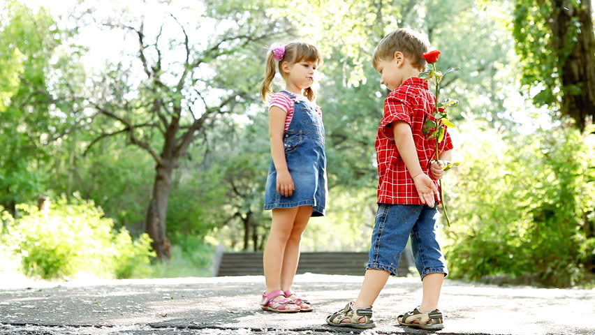 Two child speaking and boy present flower | Shutterstock HD Video #3335684