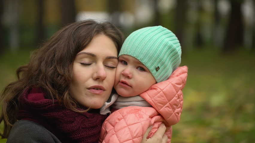 Portrait of beautiful young woman with a child in an autumn park. Portrait of two, young mother and daughter. slow-motion | Shutterstock HD Video #33368164
