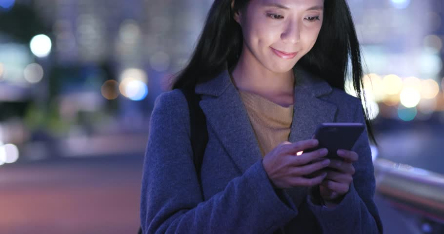 Young Woman use of mobile phone in city at night | Shutterstock HD Video #33405355