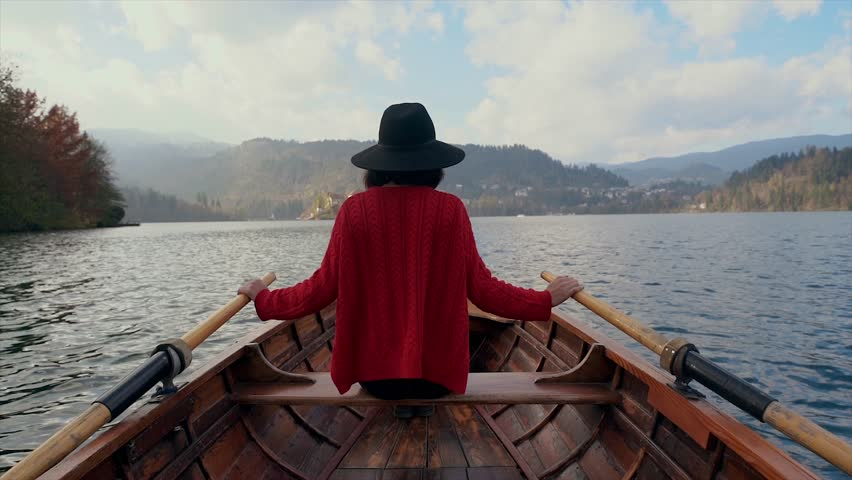 A hipster woman traveling by boat in a lake | Shutterstock HD Video #33428434