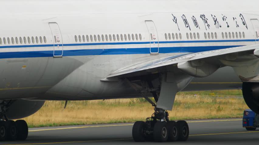 FRANKFURT AM MAIN, GERMANY - JULY 17, 2017: Air China Boeing 777 B-7952 towing from service. Fraport, Frankfurt, Germany #33428521
