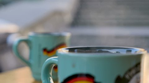 Steaming Cup of Hot Mulled Gluehwein at German Market in British Town