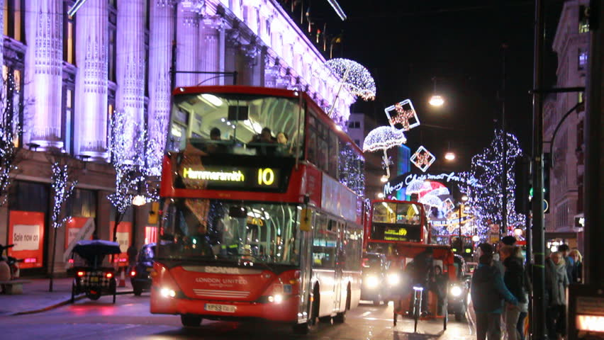 LONDON, UK - DECEMBER 27: Traffic of cars and double buses on drive past Selfridges on Oxford Street at Christmas on December 27, 2012 in London, UK. Oxford Street is a big shopping street in London