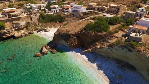 Aerial birds eye view video taken by drone of fishing village of Mezapos with green clear waters, Mani, Laconia, Peloponnese, Greece