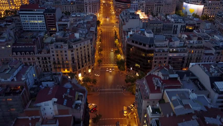 Reverse Fly Over at Dusk of Barcelona Street