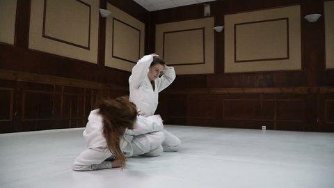 Fight. Girls train for training in judo and jujitsu