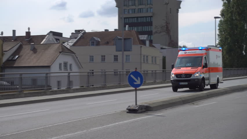 PASSAU, BAVARIA/GERMANY - SEPTEMBER 09, 2017: Emergency ambulance with siren and lights flashing. The development of ambulance services in Germany started in the late 19th century.