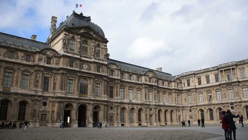 Paris, People takes selfie in front of the Louvre Museum, France
