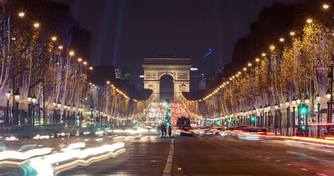 Christmas in Paris. Timelapse of avenue des Champs-Elysees with Christmas lighting leading up to the Arc de Triomphe in Paris, France. Crash zoom effect.