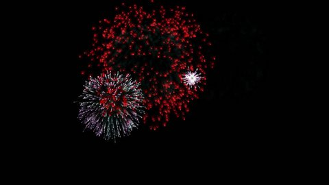 Multicolor fireworks loop alpha transparent 4K animation.  alpha channel + red yellow pink purple white and blue fireworks at night background.  Happy New Year holiday celebration fireworks.