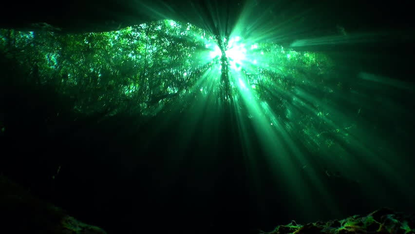 Reflection of sunlight in caves of Yucatan cenotes underwater. Clean and clear underground water in Mexico.