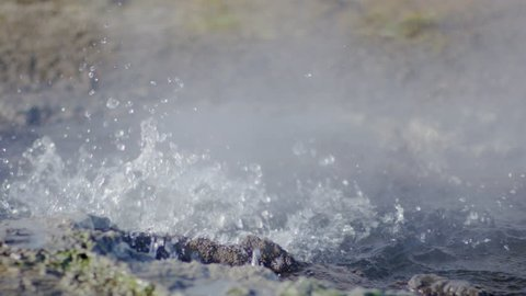 Closeup Of Small, Yet Dramatic Geyser Eruption, Water Bubbles And Sprays, Steam Rises, In Iceland - Shot On Red Scarlet-W Dragon In Slow Motion, 4K
