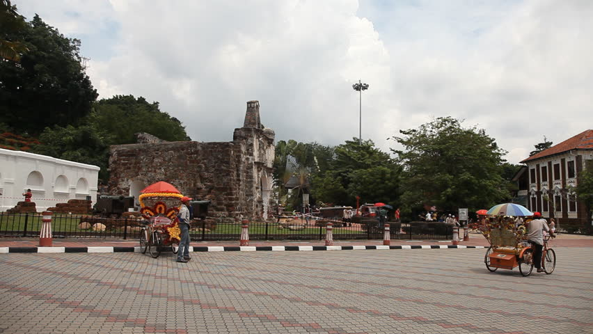MALACCA 4 November: timelapse of trishaw driving in front of ''A Famosa'' Malacca in Malaysia on 4th November 2012