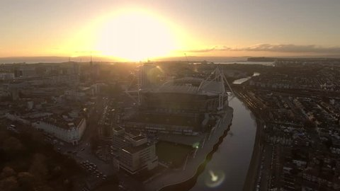 Panning aerial shot of Cardiff city centre and Cardiff bay area at sunrise.
