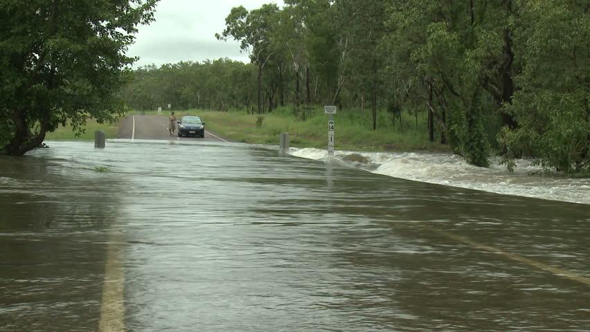 DARWIN, AUSTRALIA - FEBRUARY 2011. Car Drives Through Flooded Road - Full HD 1920x1080 30p shot on Sony EX1.