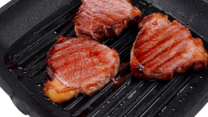 Fresh Grilled Beef Steaks On Black Grill Plate Hidef Slow Motion Intro Hd Stock