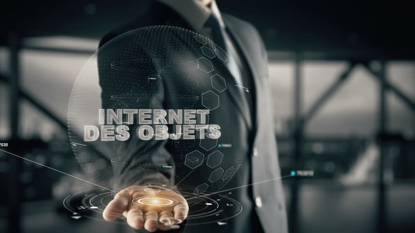 Internet des objets (French) with hologram businessman concept, in English Internet of things #33631084