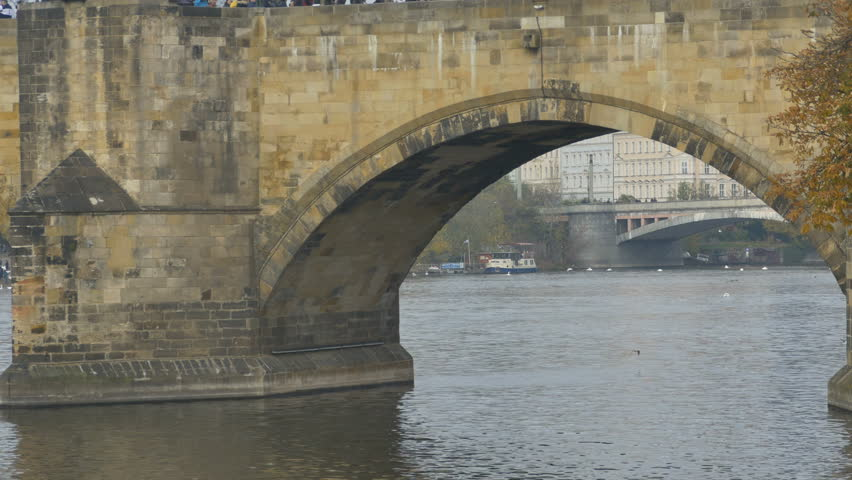 Medieval stonework footbridge view over river.   Shutterstock HD Video #33637924
