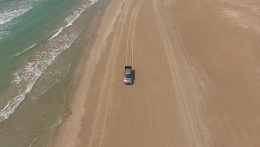 Aerial Shooting From Flying Drone Of A Silver Pickup Machine Is - 12 extreme ocean adventures