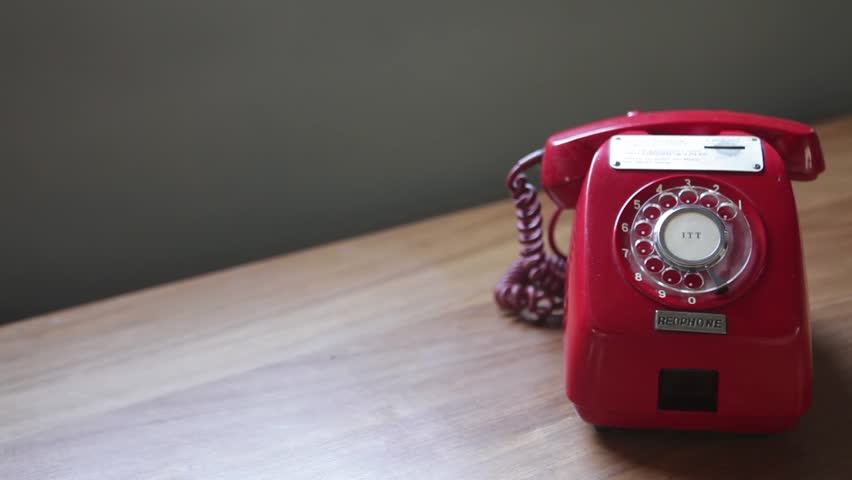 dolly shot of old vintage rotary coin red phone