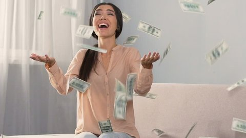 Lots of cash falling on happy surprised girl, favorable bank loan terms, money