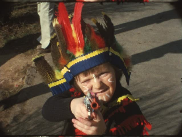 Boy aiming with toy gun (vintage 8mm)