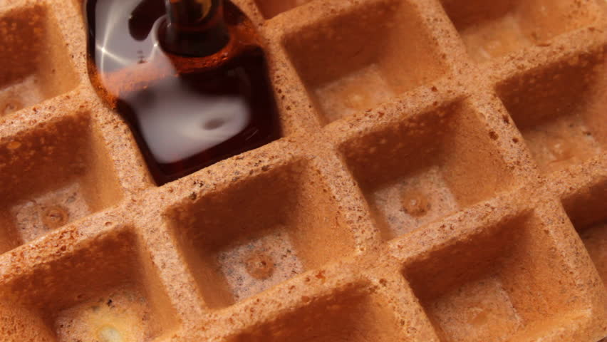 Maple syrup runs on golden brown waffle
