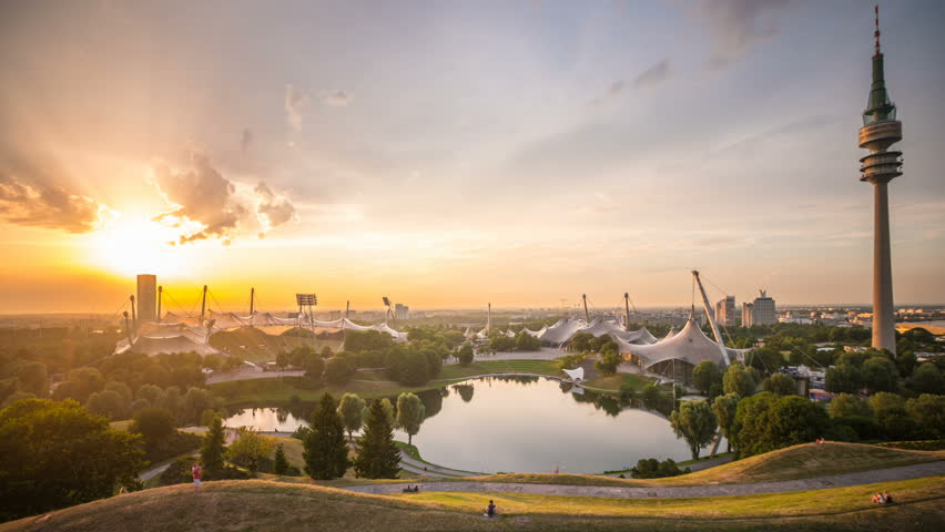 Sunset of Olympic Park Munich with TV Tower, Olympic site, Olympic Park with the television tower and Olympic Lake, Munich, Bavaria Time-lapse video. Munich city Skyline Cityscape lapse with clouds.