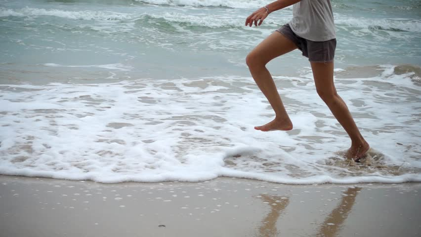 Woman runing on sand beach in Slow motion. #33733024