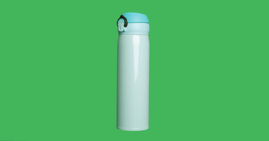 Isolated blue thermos with hot drink on green screen chroma key background.  360 degrees looped rotation shot.