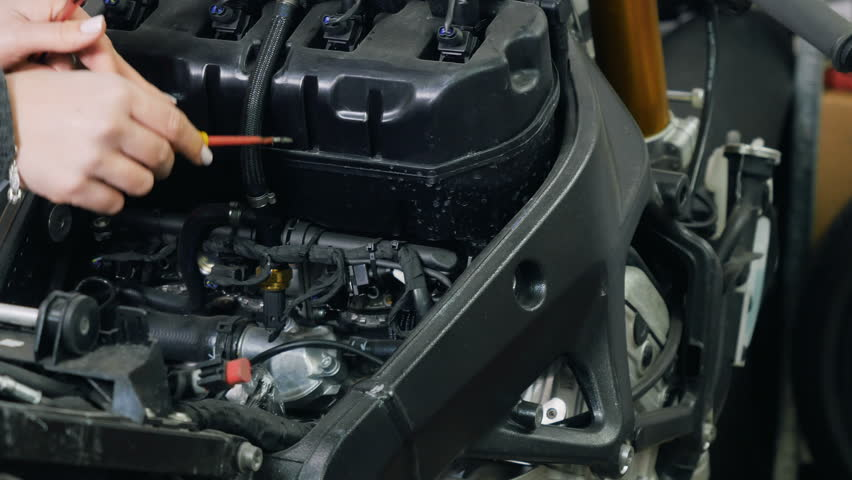 Woman tries to repair the engine | Shutterstock HD Video #33767224