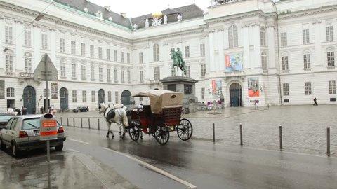 the vehicle used by horses, moves across Vienna Josefsplatz
