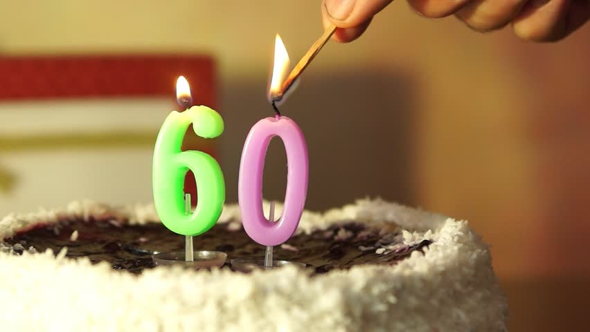 Ten years anniversary man lights candles on birthday cake stock man lights candles on birthday cake hd stock video clip sciox Image collections