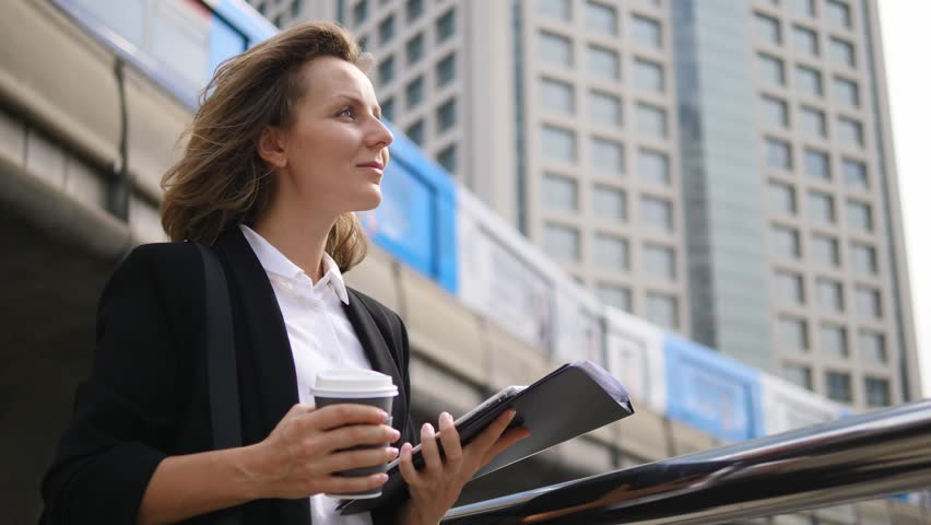 Business Woman With Tablet On City Background. Slow Motion. 4K.  | Shutterstock HD Video #33833764