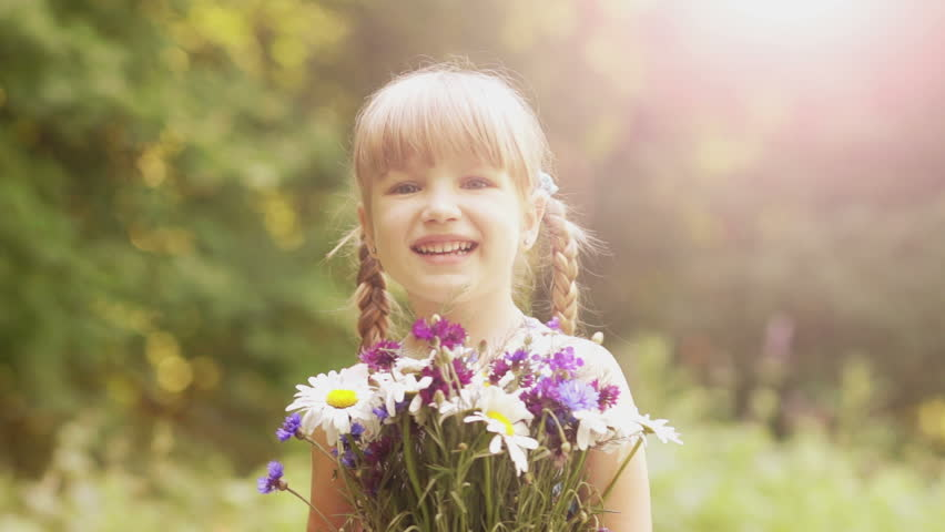 Happy children playing outdoors in spring park stock footage video laughing girl with a bouquet of flowers hd stock footage clip altavistaventures Image collections