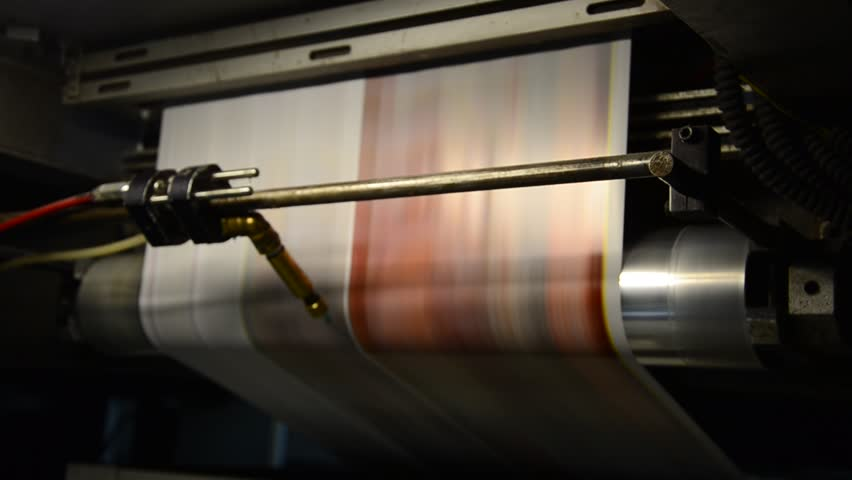offset print press hit set roll paper goes through the rollers and is read by the color management camera, after passing the printing units