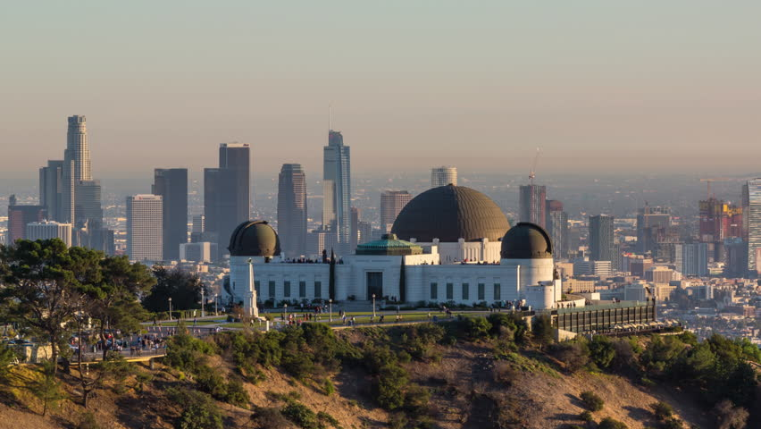 Los Angeles, California, USA - December 13th 2017 - Beautiful Downtown Los Angeles and Griffith Observatory Golden Hour Hyperlapse