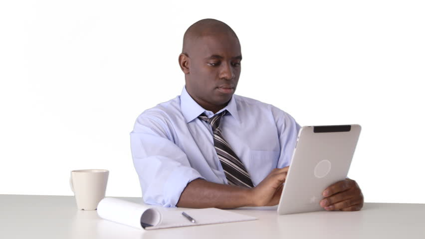 African American businessman working on tablet and taking notes | Shutterstock HD Video #3389354