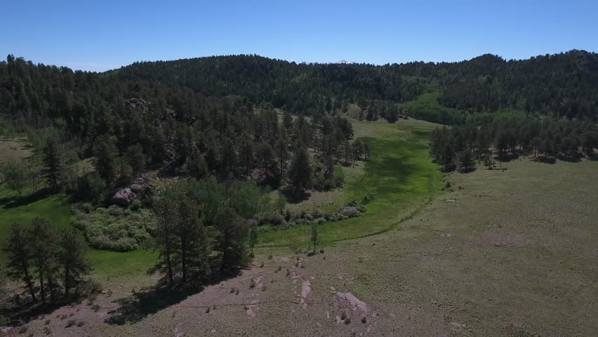 Drone aerial 4k video of colorado ranch taken at beautiful light including streams, bees, deer, antelope, elk, hay, tractors, and much more   Shutterstock HD Video #33947584