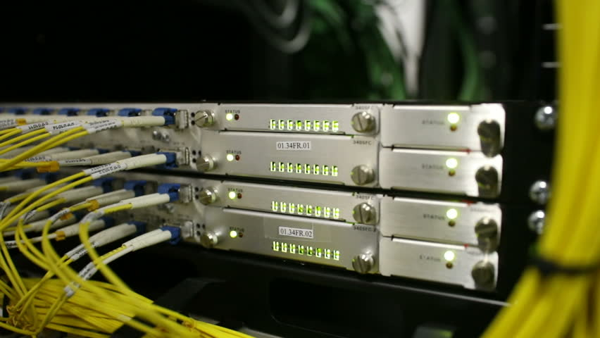Optical server. Commutator. flashing lights. Optical fiber. Video IP Gateways. Audio. Severs computer in a rack at the large data center. Rack Mounted Servers.