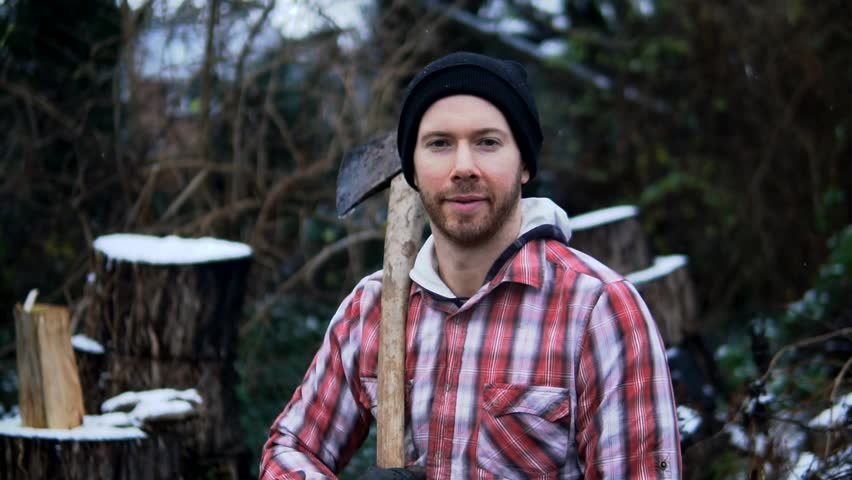 Portrait Of Happy, Proud Lumberjack Worker, Brave Man With Dedication. Outdoor Snow In Cinematic Slow Motion. White Caucasian Man Working In Nature.