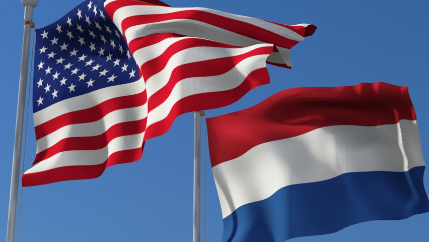 Flag Of Usa And Netherlands Waving In The Wind Against Blue Sky Three Dimensional Rendering