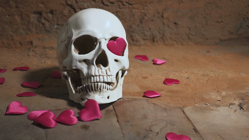 Human skull with red heart . Hearts fall on the skull slow motion. Concept for Valentine's Day. AIDS | Shutterstock HD Video #34037554