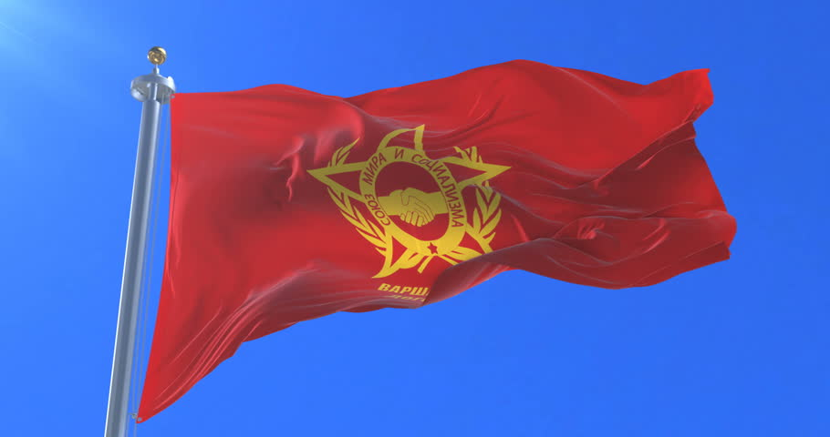 Warsaw Pact flag waving at wind with blue sky, loop