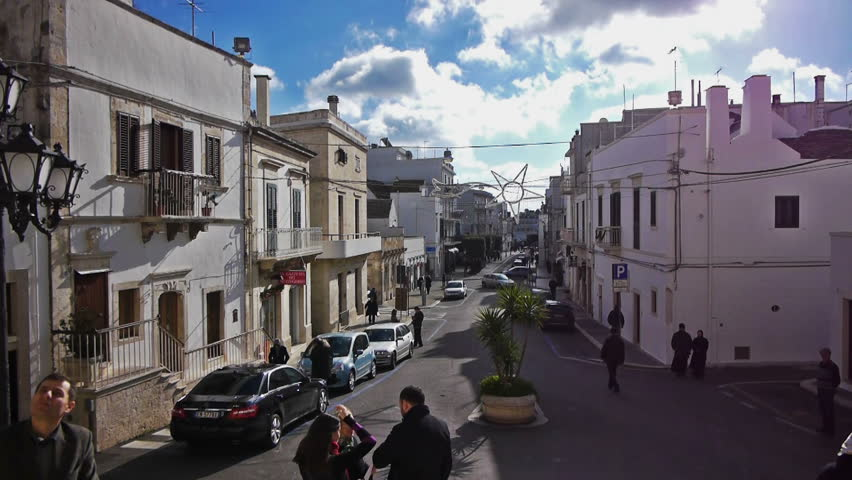 ALBEROBELLO, ITALY - December, 18: Street leading to Saint Cosma and Damiano Basilica on December, 18, 2012, Alberobello, Italy. Alberobello is UNESCO World Heritage Site highly visited all year round