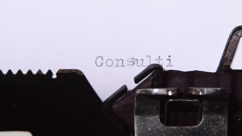 Word consulting printed on a retro typewriter. Close up