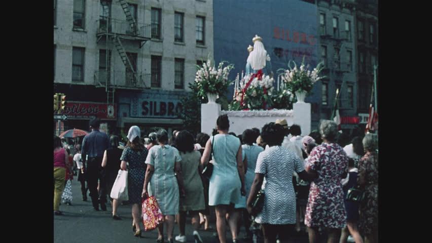 NEW YORK, 1971, Italian religious festival parade in East Harlem, crowd of Italian women following the float