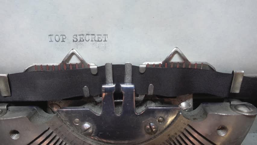 Typing TOP SECRET at the typewriter | Shutterstock HD Video #34190824